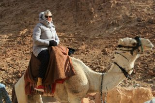 Granny in the desert without her rollers!